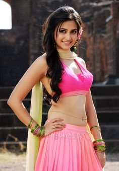 Kriti Kharbanda is an Indian film actress and model who appears in Kannada and Telugu films. Born in New Delhi and brought up in Bengaluru, she worked as a commercial model before making her acting debut in the 2009 Telugu film Boni.