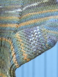 A basic recipe to make great fitting toe-up socks for any size foot and with any weight yarn – knitting two socks at a time, using magic loop technique, and featuring a gusset and heel flap with Eye of Partridge stitch.