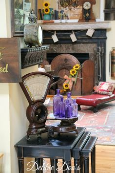 Rustic mantel and family room filled with thrifted and vintage finds.Vintage postal scale and vintage purple bottles. Learn the history of the bottles.