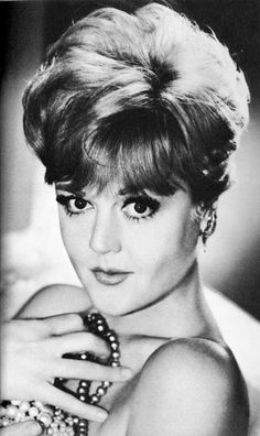 Angela Lansbury. S) This is a side of Angela Landsbury (Murder She Wrote) we haven't seen Angela married Peter Shaw on August 12,1949. They were married for 54 years before Peter died of Congestive Heart Failure at home in 2003. She is still active in the theatre.