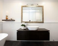 To maximise storage, the ornate framed mirror is recessed into the wall to gain extra space. Add a powerpoint or two to charge you toilet brush and plug in your hairdryer. Bathroom designed by Hayley Dryland of Bespoke on Khyber
