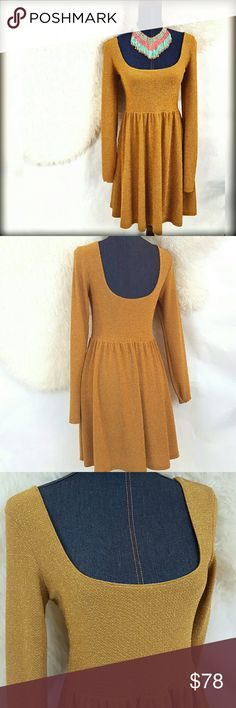 """30%/2📮Free People M Gold Fit Flare Holiday Dress Just lidted! Gorgeous gold dress by Free People . Featuring a low neckline that is echoed in the back. A bit of sparkle woven in makes for a dress that can be dressed up or down. Would be stunning with booties or red heels. Machine wash. Medium.  VGUC- no tears, stains, etc. Approximate Flat Measurements: Bust: 17"""" Length: 34"""" Free People Dresses Long Sleeve"""