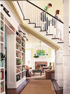 love. floating stair. Really like this idea.  Several years ago I was in a model home that had the stairway in the middle - it was an excellent floor plan.