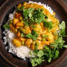 "Vegetarian Korma | ""This is an easy and exotic Indian dish. It's rich, creamy, mildly spiced, and extremely flavorful. Serve with naan and rice."""