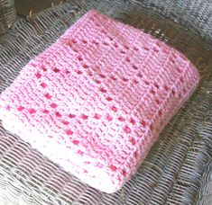 This simply beautiful crochet baby blanket is perfect for your sweet babe. This heirloom baby blanket is crocheted in a unique diamond trellis pattern... There will be plenty of oohs over this one! { HANDMADE } This lovely blanket is ready to ship. { MATERIALS } Pink acrylic yarn.