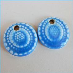 Made with porcelain clay. They have round shape and a…