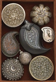 A collection of paisley-and-floral embellished boxes. Top right hand box... I have a plain one that I could tinker with... :D