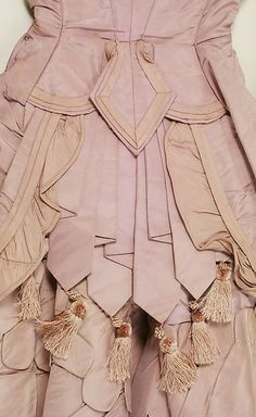 """""""Dress, ca. 1871"""" What great detailing. Pleated layers with tassel fringe beneath what looks similar to a button cinched waist."""