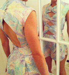 Alissa in our NYC store wears Clique Twist Playsuit in Sorbet Floral