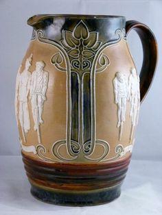 Doulton Lambeth Cycling Jug. Louisa Wakely. 1900-1919 art nouveau pottery ceramics clay