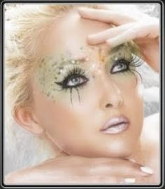 Fairy look for Halloween with dramatic eyelashes pearl lips sparkle embellishments frosted lips dramatic black eyeliner