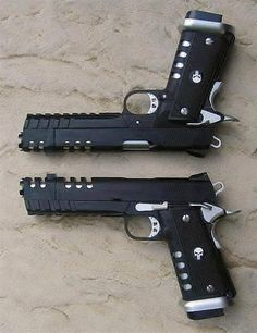 Dual 1911's w/ Punisher skulls on grips