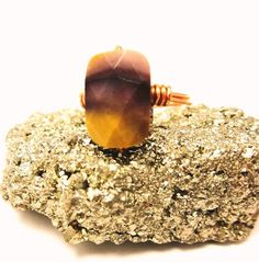 Beautiful natural Australian Mookaite stone ring with 11x7mm faceted flat square bead. Colors of mustard, mauve and plum reminiscent of shades of evening in the dusty Outback :)     $12.00