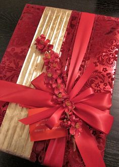 Beautiful red and gold with artificial flowers.  Very pretty.