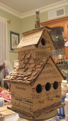 Vintage sheet music bird house with shingles***Research for possible future project.