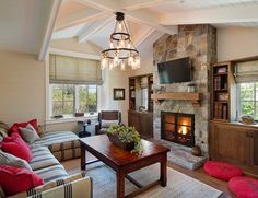 Farmhouse Living Room by Anne Sneed Architectural Interiors Love the RED accents throughout..including the oven .