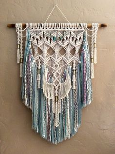 This is a fabulous layered Bohemian Large Macrame Wall Hanging with brass tubes and beautiful beading. There are two different ones pictured in a variety of textured yarns.Large colored macrame wall hanging woven wall hanging boho decor home decor bohemia Large Macrame Wall Hanging, Yarn Wall Hanging, Tapestry Wall Hanging, Wall Hangings, Macrame Design, Macrame Art, Macrame Projects, Modern Macrame, Textured Yarn