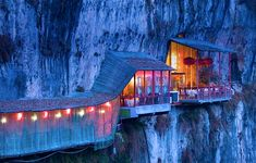 Hanging on the side of a cliff is Fangweng Restaurant in Hubei Province, China