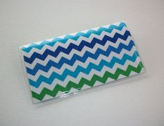 Checkbook Cover / Holder / Case   Blue and green lime by Laa766, $6.75  . Die-cut flaps in the top and bottom of the cover allow you to easily insert your checkbook register and separate your duplicate checks.