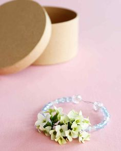 Here's a way to put those freshly-picked backyard blooms to use! String them into one-of-a-kind bracelets. They are perfect for Mother's Day, a kid's birthday party, or any day that needs a colorful pick-me-up.