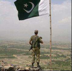 Pakistan Flag Lovers - A soldier guarding border post under a waving Pakistani flag - Display of Pakistani flag