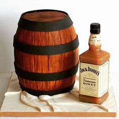 A barrel containing a rich chocolate whisky cake & a bottle containing a whisky spiked caramel sauce to go with it.. #barrel #whiskey #whiskeybottle #whiskeybarrel #whisky #jackdaniels #jackdanielshoney #caramel #fondant #cake #chocolate #thecakelab