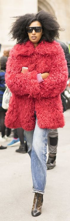 Paris Fashion Week Street Style: Julie Sarr-Jamois wearing a fuzzy red coat, relaxed jeans, and Louis Vuitton heels