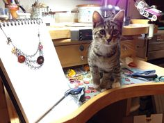 Crowley the curious kitten was helping me NOT finishing the necklace for a collector. A kitten in the studio is very distracting :)