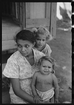 """Title: [Untitled photo, possibly related to: Family in slum area known as """"El Machuelitto,"""" in Ponce, Puerto Rico]   Creator(s): Delano, Jack, photographer   Date Created/Published: [1941 Dec.]"""