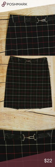 Anne Taylor black plaid knee length skirt Adorable black knee length skirt. Pleated in the back as shown in picture. Buckle on front. Red and white stripes. Perfect with the new trend of knee highs! Channel your inner clueless! Ann Taylor Skirts A-Line or Full