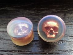 "Clear Plugs With Copper Skull - 0g 8mm - 00g 10mm  - 7/16"" 11mm - 1/2"" 12mm - 9/16"" 14mm - 5/8"" 15mm - 3/4"" 19mm - 7/8"" 22mm - 1"" 25mm by OjingoStudio on Etsy https://www.etsy.com/listing/162214944/clear-plugs-with-copper-skull-0g-8mm-00g"