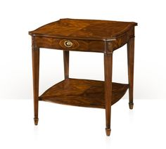 A flame mahogany lamp table 5005-418 A flame mahogany lamp table, the serpentine top above an oval inlaid frieze drawer with brass handle, the floral carved capital and tapering, fluted legs joined by an undertier. The original Regency. W 25 x D 25 x H 27