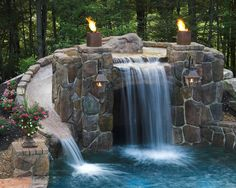 Pool Grotto/fire features/slide. This one is in our budget :-)