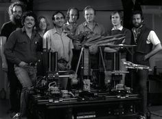 In foreground, computer controlled (via stepper motors) Go-Motion rig with Dragon puppet attached