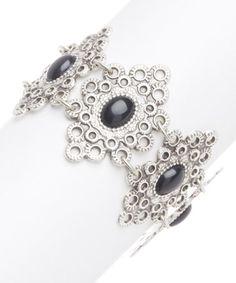 This Silvertone & Black Circle Filigree Bracelet is perfect! #zulilyfinds