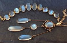 Art Deco 9kt Gold Blue-Hue Moonstone Necklace and Bracelet Suite | Marker's mark M&M, which may stand for James Woodward and Wilfred Mole who traded as Manton & Mole | Collectors Weekly