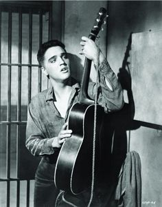 """Elvis Presley, in character as """"Vince Everett"""" in a scene from """"Jailhouse Rock"""", 1957 King Elvis Presley, Elvis Presley Movies, Elvis Presley Images, Are You Lonesome Tonight, King Creole, Best Guitar Players, Young Elvis, Jailhouse Rock, Cinema"""