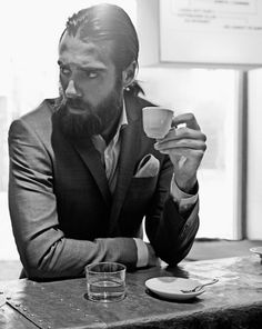 beard and a cup of coffee