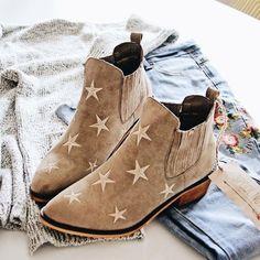 Cute tan suede booties with star print in beige.