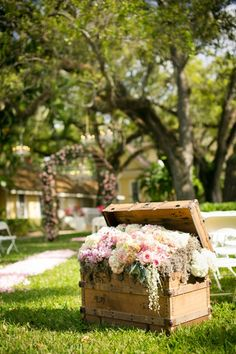 how gorgeous is this trunk filled with floral used at the entrance to the aisle?
