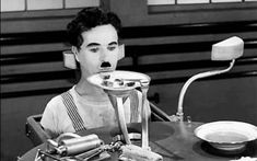 In this clip from the classic 1936 film Modern Times, Charlie Chaplin is an assembly line worker struggling to live in a society driven by the industrialization of the Machine Age. While on his lunch Stan Laurel, Mabel Normand, Charlie Chaplin Modern Times, Eating Gif, Chaplin Film, Rube Goldberg Machine, Charles Spencer Chaplin, Movie Gifs, Man Ray