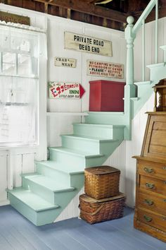 A light mint green makes this staircase in Stacey Digiovanni's home in Brooklin, Maine feel fresh and brightens up the narrow space. The house was built in 1885 but still feels airy and beachy thanks to her playful color choices.