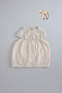 snow white baby knit dress. 100% cashmere handknit dresss. available mid october.
