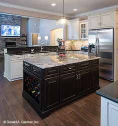 This kitchen island features a built in wine rack. The Travis #1350.