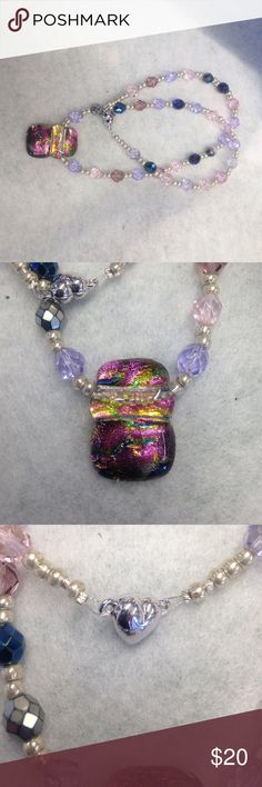 Dichroic glass pendant Dichroic glass pendant strung on crystal necklace with magnetic clasp.  20 inch length Jewelry Necklaces