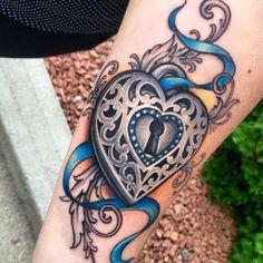 Heart locket tattoo by Jessica Brennan @powerline tattoo Cranston, heart lock