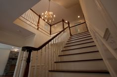 Staircase in a custom modular colonial home by Coyle Modular Homes of Newtown, CT.   To learn more about building your new home with Coyle, visit www.coylehomes.com.