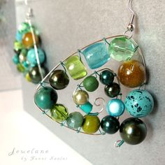 Jewelane by Fanni Szalai  Improvisation in blue-green... wood / metal / stone / acrylic beads / silver plated copper wire  www.facebook.com/pages/Jewelane/149041948635892