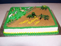 John Deere Birthday - Cake for a 3 year old.  Mom furnished the tractor , plow and trailer.  Fence, hay, rocks and feed trough are of fondant.  Buttercream on chocolate fudge cake.  This was about my 4th cake to do.