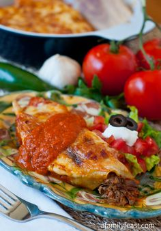 Beef and Bean Enchiladas - Made with perfectly seasoned shredded beef, refried beans and cheese.  This recipe is so delicious!  Plus a link to an easy homemade Enchilada Sauce.